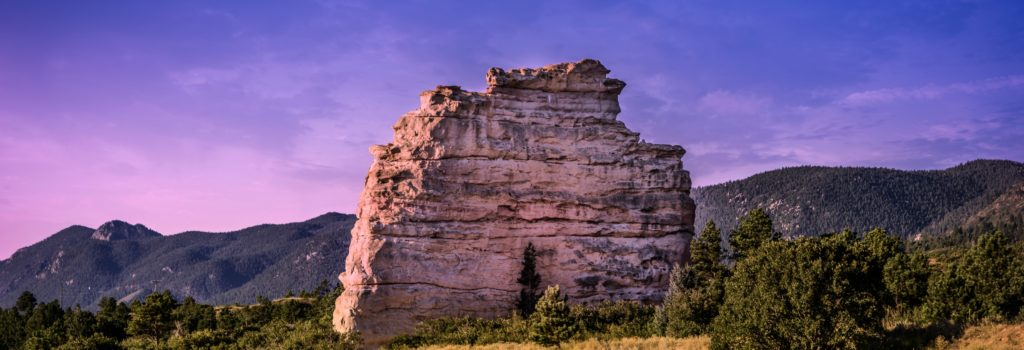 Financial Future Services-photo of rock formation in Colorado during sunriseFinancial Services-time and money icon Financial Future Services Monument Colorado